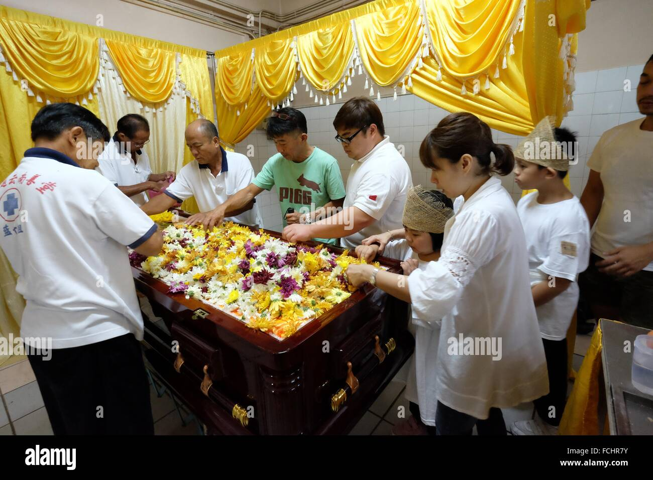 Relatives putting flowers into the coffin sarawakian chinese relatives putting flowers into the coffin sarawakian chinese funeral ceremony malaysia izmirmasajfo