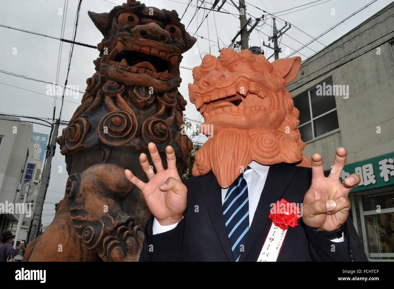 Naha, Okinawa, Japan: performer wearing a Shisa mask in Tsuboya during the ´Shisa Day´. Shisa is a traditional - Stock Image