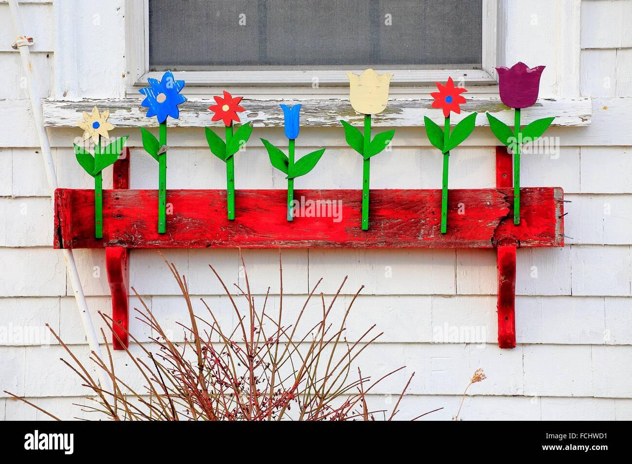 Folk art on a flower box on a community hall in nova scotia, canada - Stock Image