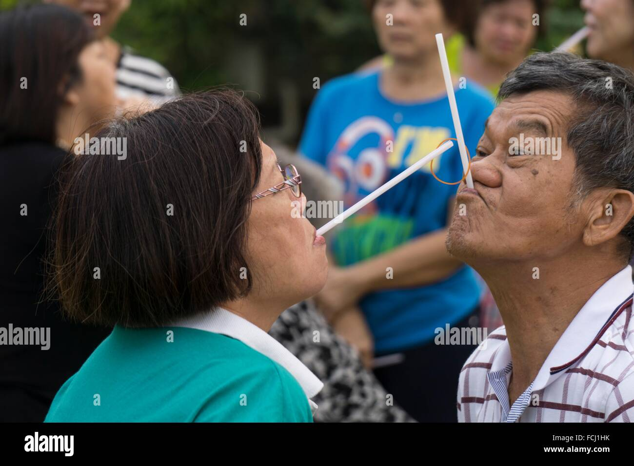 Passing The Rubber Band With Straw By Mouth Game Played At