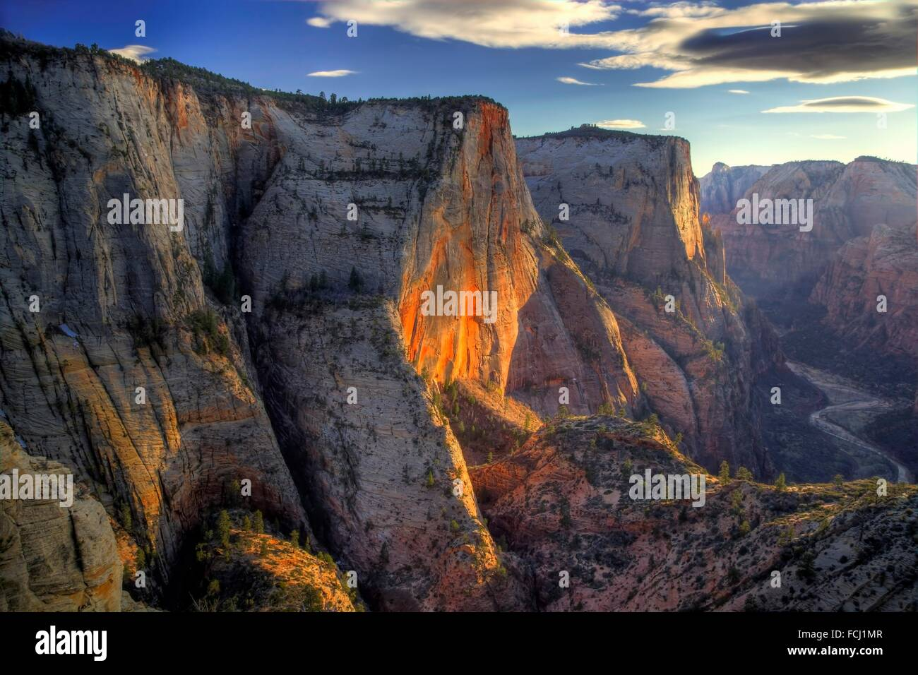 Cable Mountain shines brightly during sunset from the Observation Point Trail at Zion National Park, Utah. - Stock Image