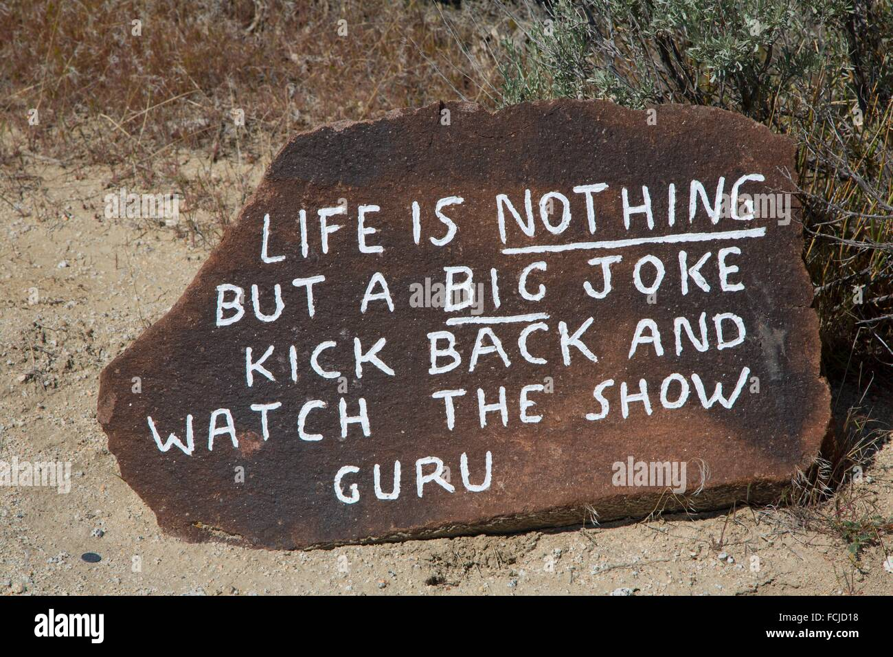 Guru folk saying rock, Guru Road, Gerlach, Nevada. - Stock Image