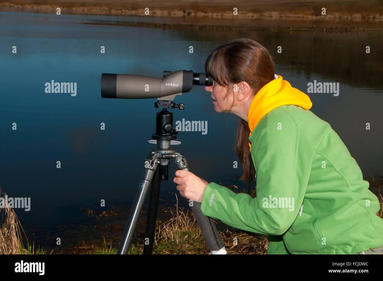 Birding with spotting scope, Baskett Slough National Wildlife Refuge, Oregon. - Stock Image