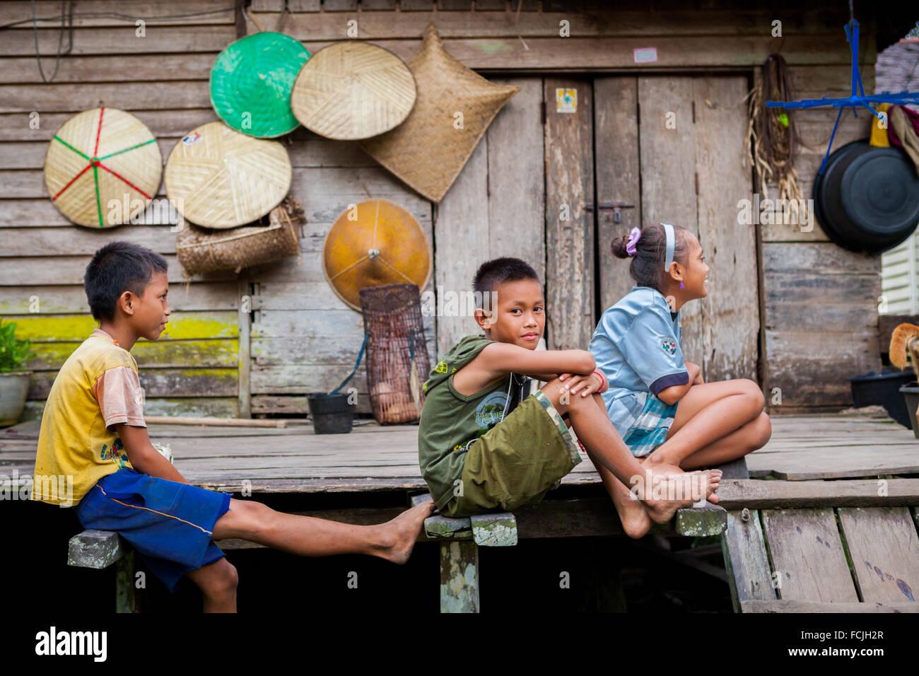 Dayaknese children gather on free time in remote district of Kapuas Hulu, West Kalimantan, Indonesia. © Reynold - Stock Image