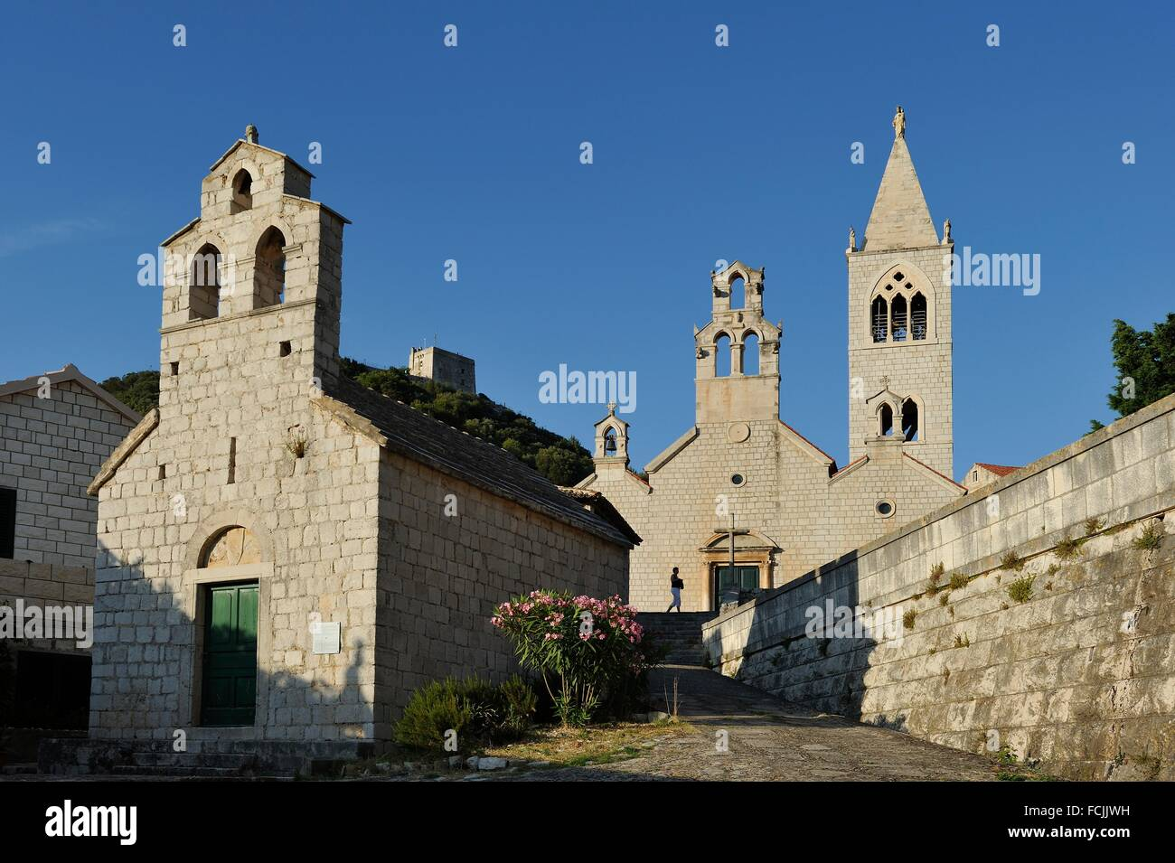 church of Saint Blaise 12th century in front of the church of Saint Cosmas and Saint Damian 14th century, Lastovo - Stock Image