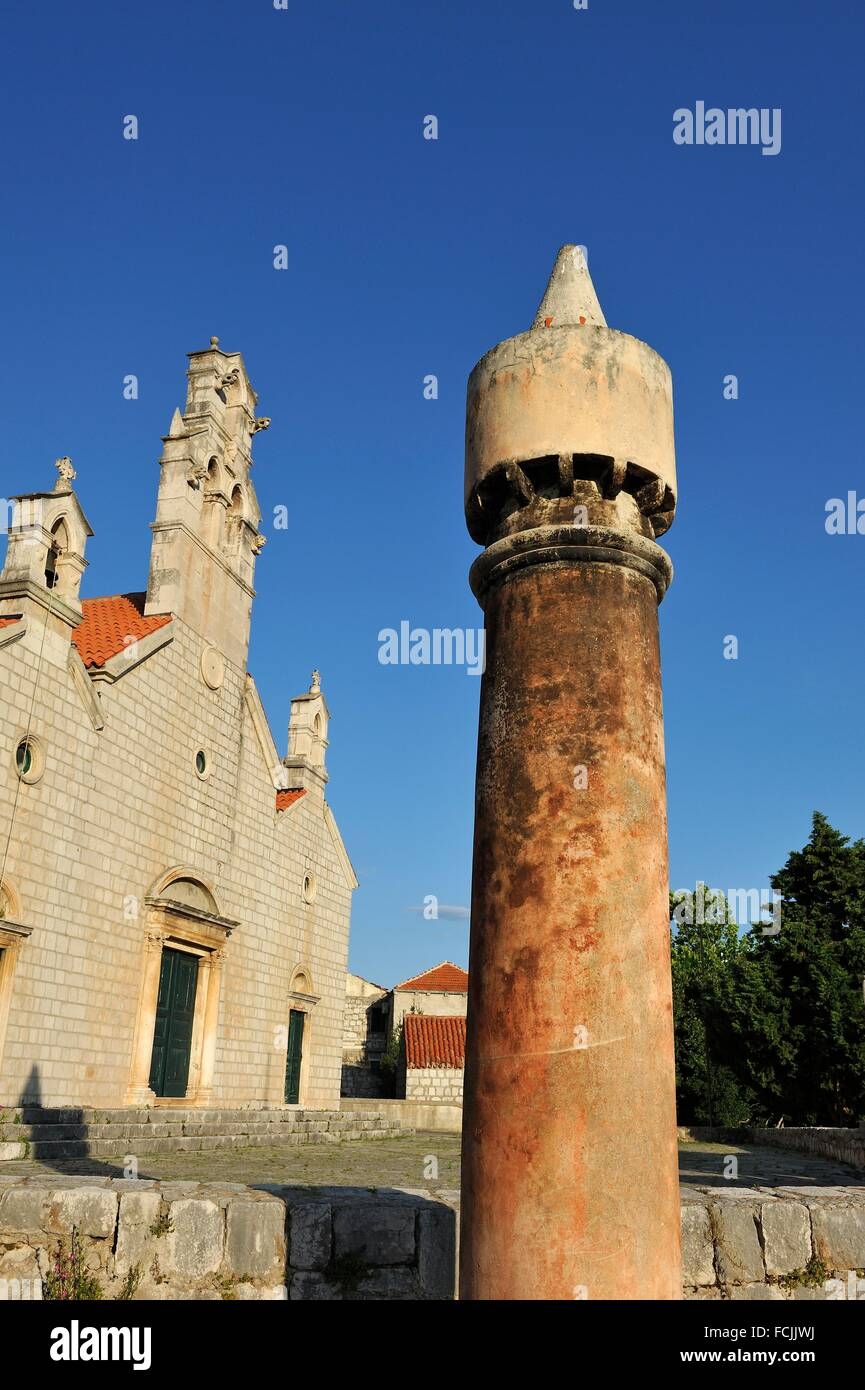typical chimney in front of the church of Saint Cosmas and Saint Damian 14th century, Lastovo town, Lastovo island, - Stock Image