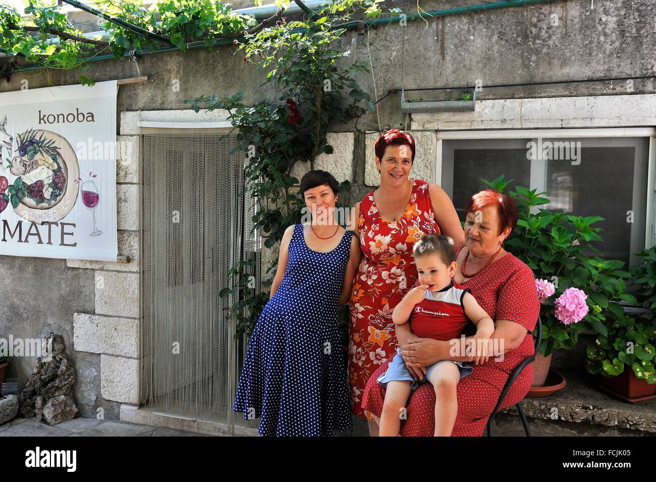 four generations of the Farac family, owner of the restaurant Konoba Mate, Pupnat, Korcula island, Croatia, Southeast - Stock Image
