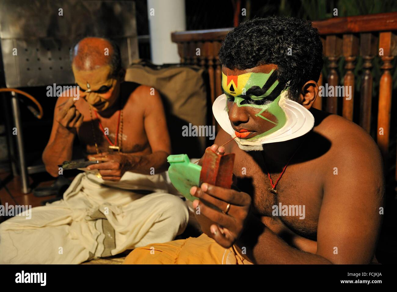 Kathakali performers during making up before a show at the Kumarakom Lake Resort hotel, Kerala state, South India, - Stock Image