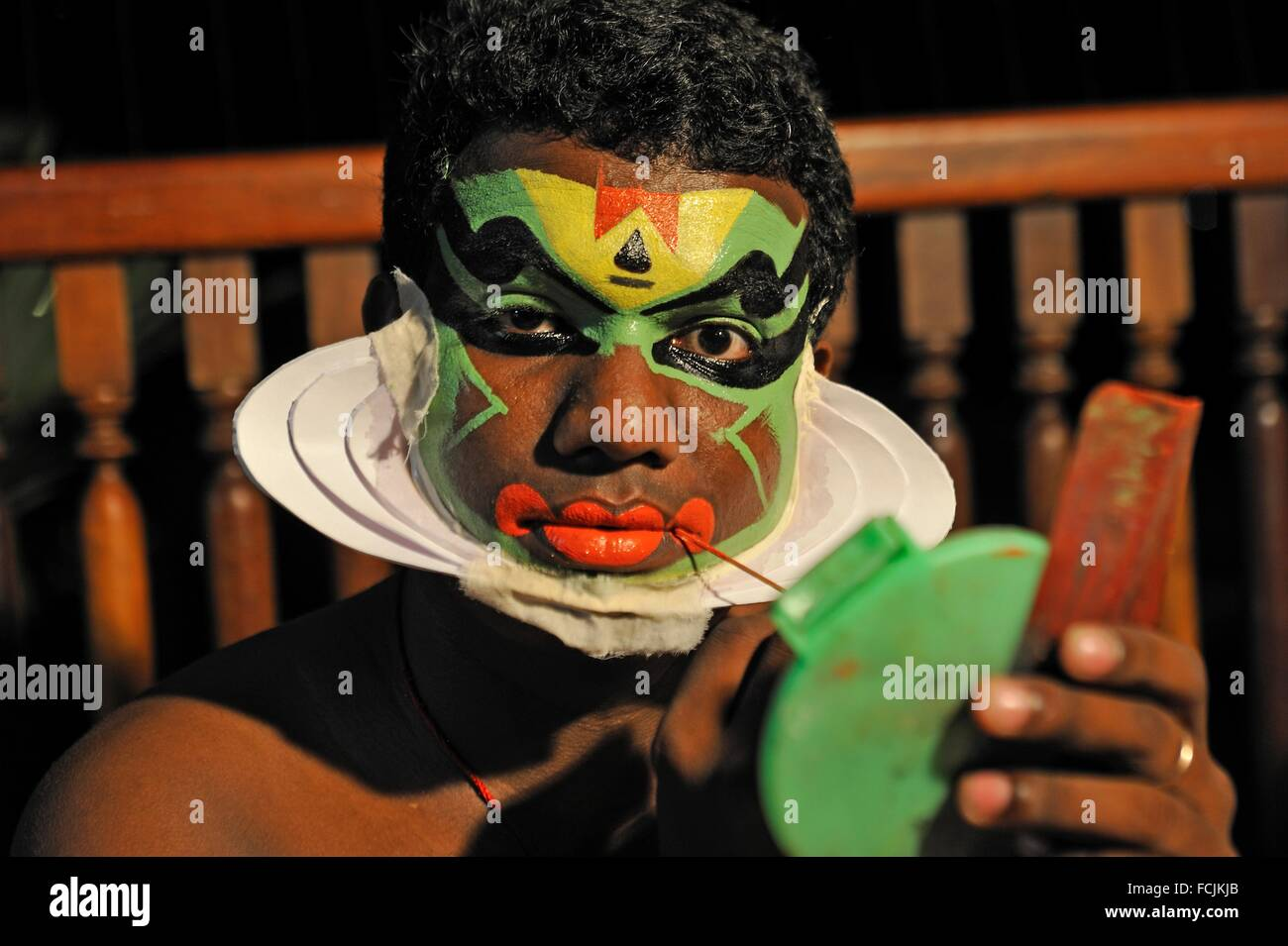 Kathakali performer during making up before a show at the Kumarakom Lake Resort hotel, Kerala state, South India, Stock Photo