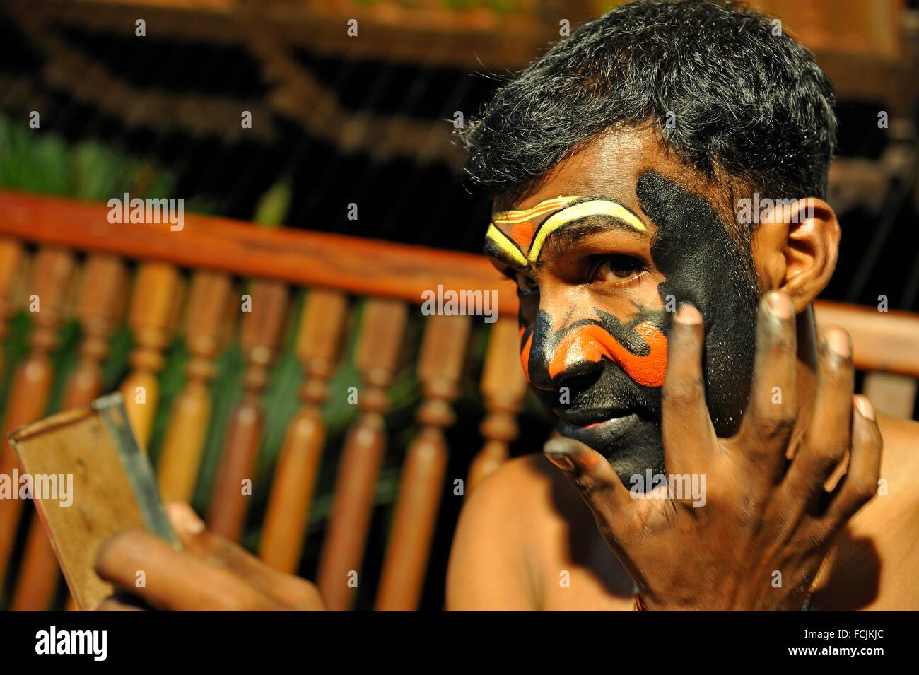 Kathakali performer during making up before a show at the Kumarakom Lake Resort hotel, Kerala state, South India, - Stock Image