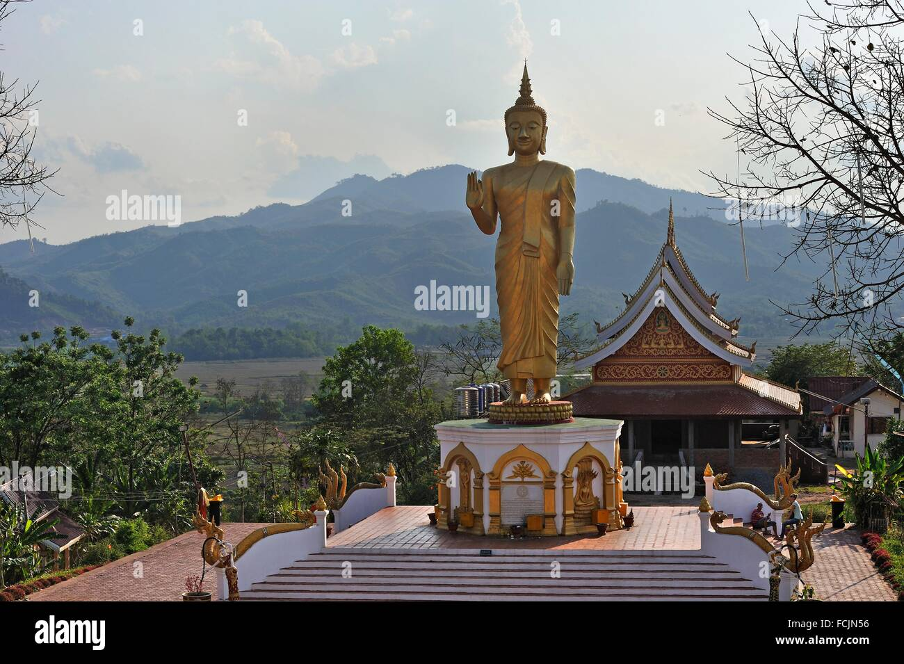 gilded Buddha´s statue at Wat Phu That temple, Udomxay, Oudomxay Province in northwestern Laos, Southeast Asia. - Stock Image