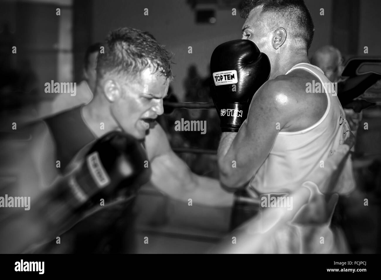 A low blow in a boxing match between two young men Stock Photo