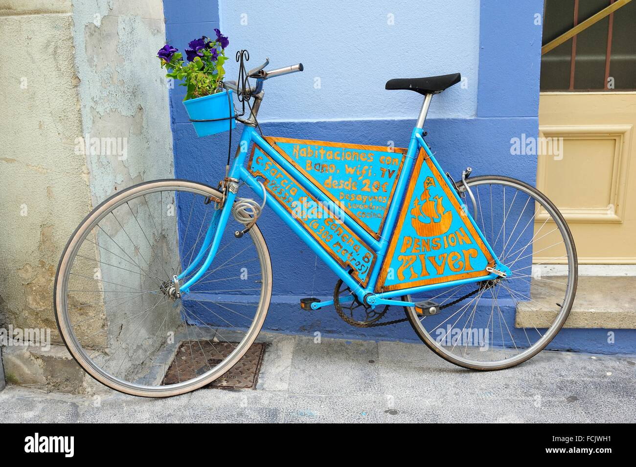 Decorative bicycle promoting Pension Alver, Cudillero, Asturias, Spain. - Stock Image