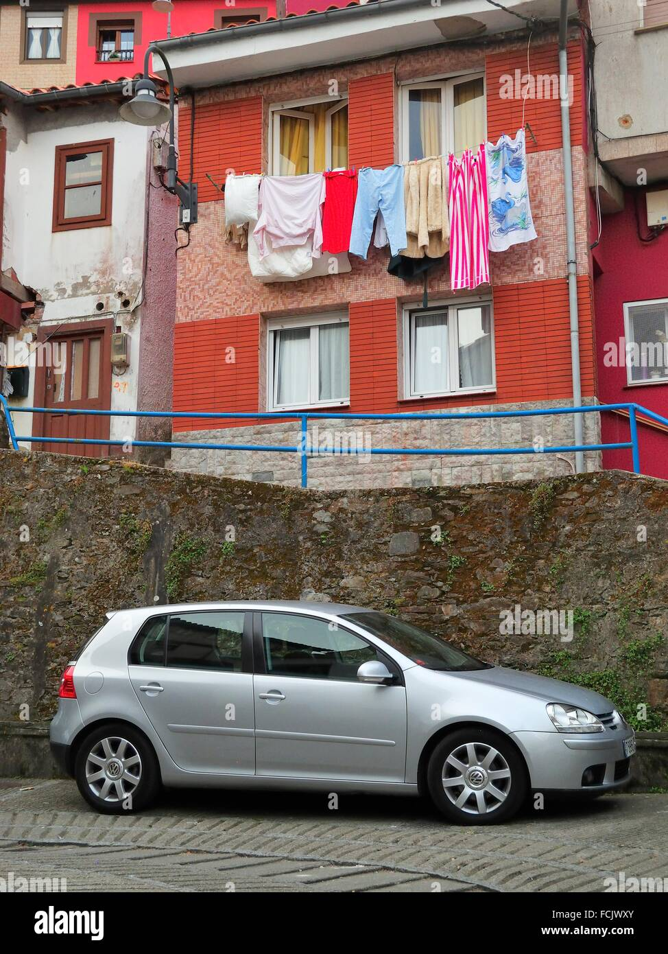 laundry drying and parked car, Cudillero, Asturias, Spain. - Stock Image