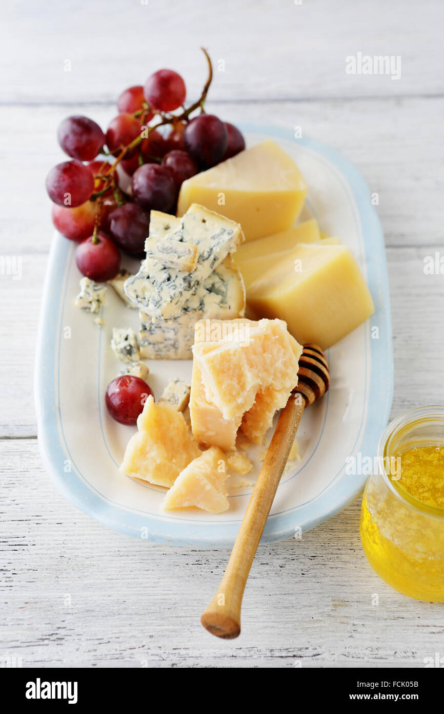 cheese platter with grapes, food close-up - Stock Image