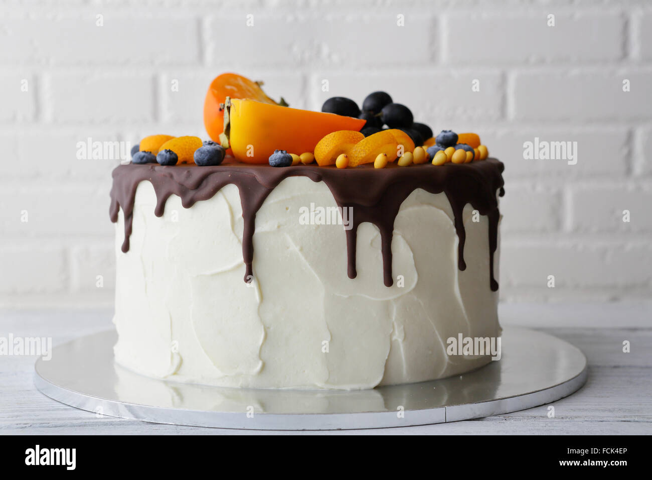white cake with chocolate icing, food close-up - Stock Image