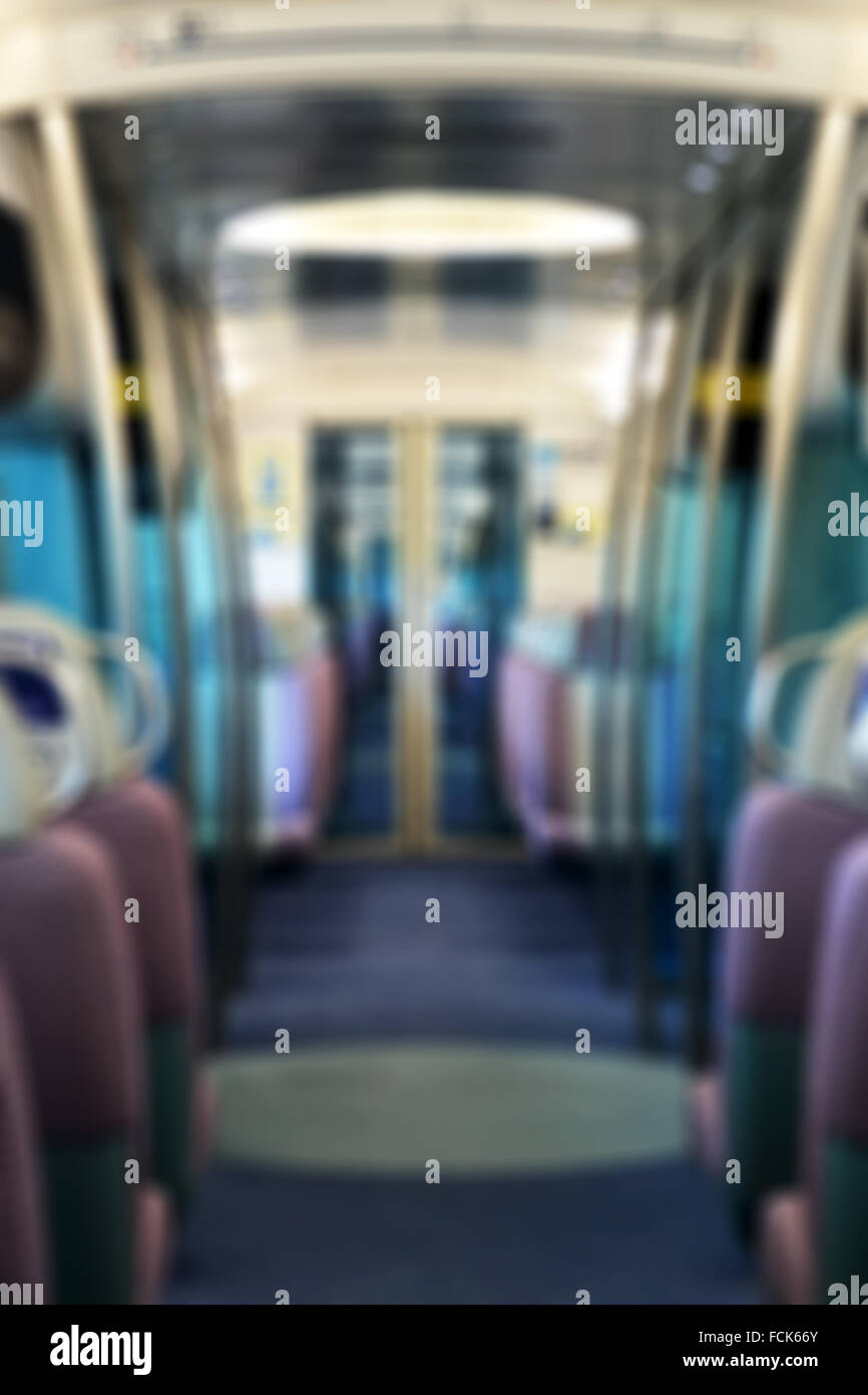 Blurred background of an empty metro train - Stock Image