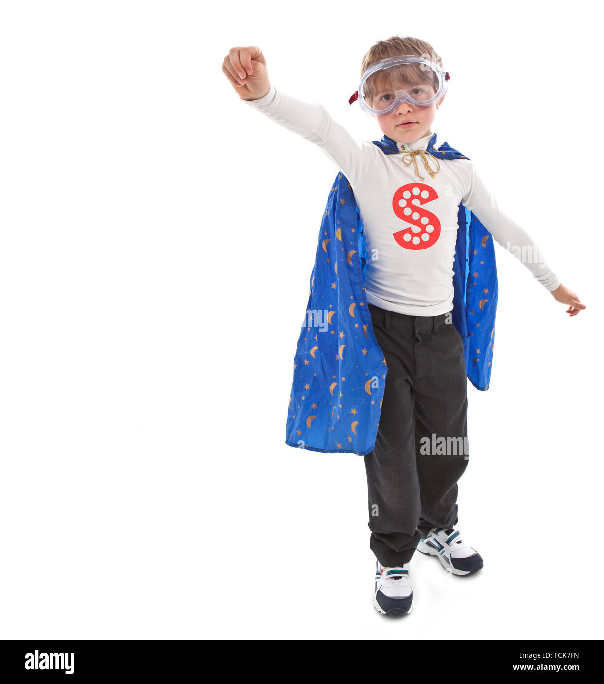 Young boy as a super hero a white background - Stock Image
