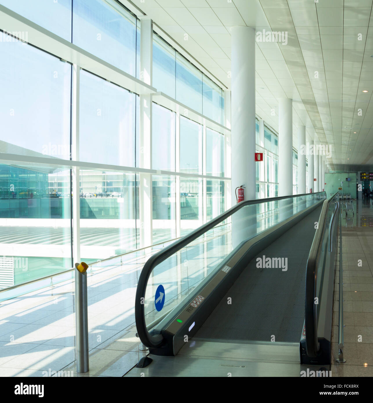Conveyor belt for people, in a luminous terminal of an airport - Stock Image