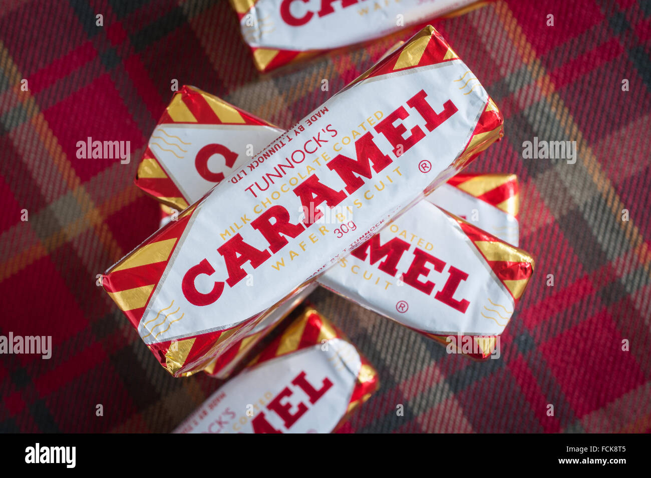 Tunnock's Caramel Wafers a chocolate covered caramel biscuit produced by Tunnocks Ltd in Uddingston Scotland - Stock Image