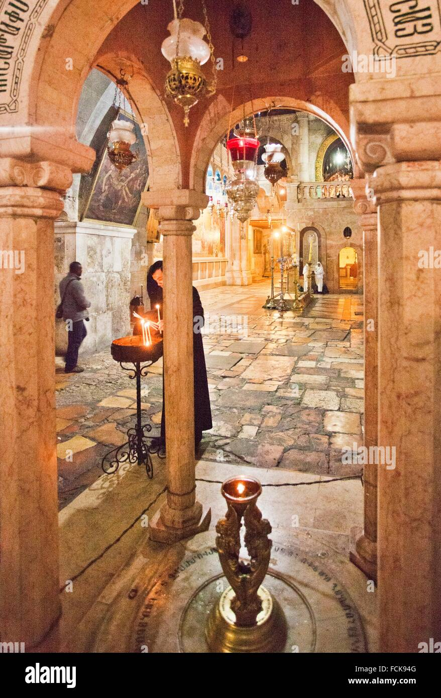 On background Stone of Unction, Church of the Holy Sepulchre, Old City, UNESCO World Heritage Site, Jerusalem, Israel. Stock Photo