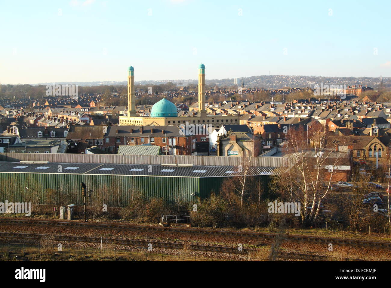 Sheffield view featuring the blue dome of the Madina Masjid mosque, Abbeydale area housing, main rail line into - Stock Image