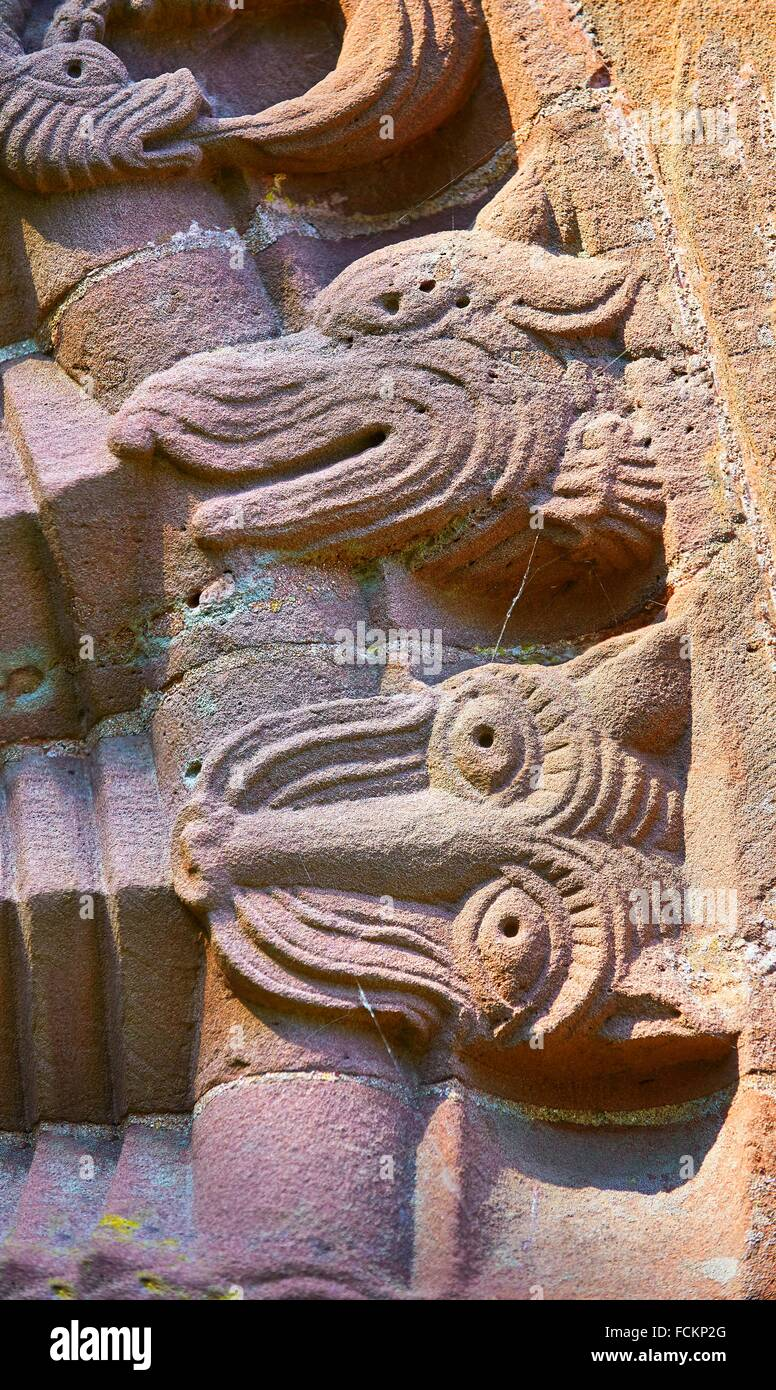 Norman Romanesque relief sculptures of dragons and mythical creatures from the South doorway of Church of St Mary - Stock Image