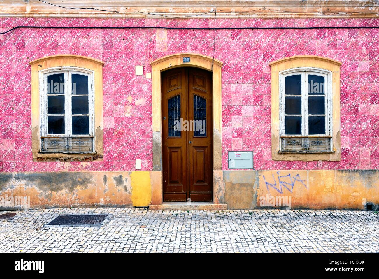 Europe, Portugal, Algarve, Faro district, Silves, former capital of Algarve, facade of traditional Portuguese townhouse - Stock Image