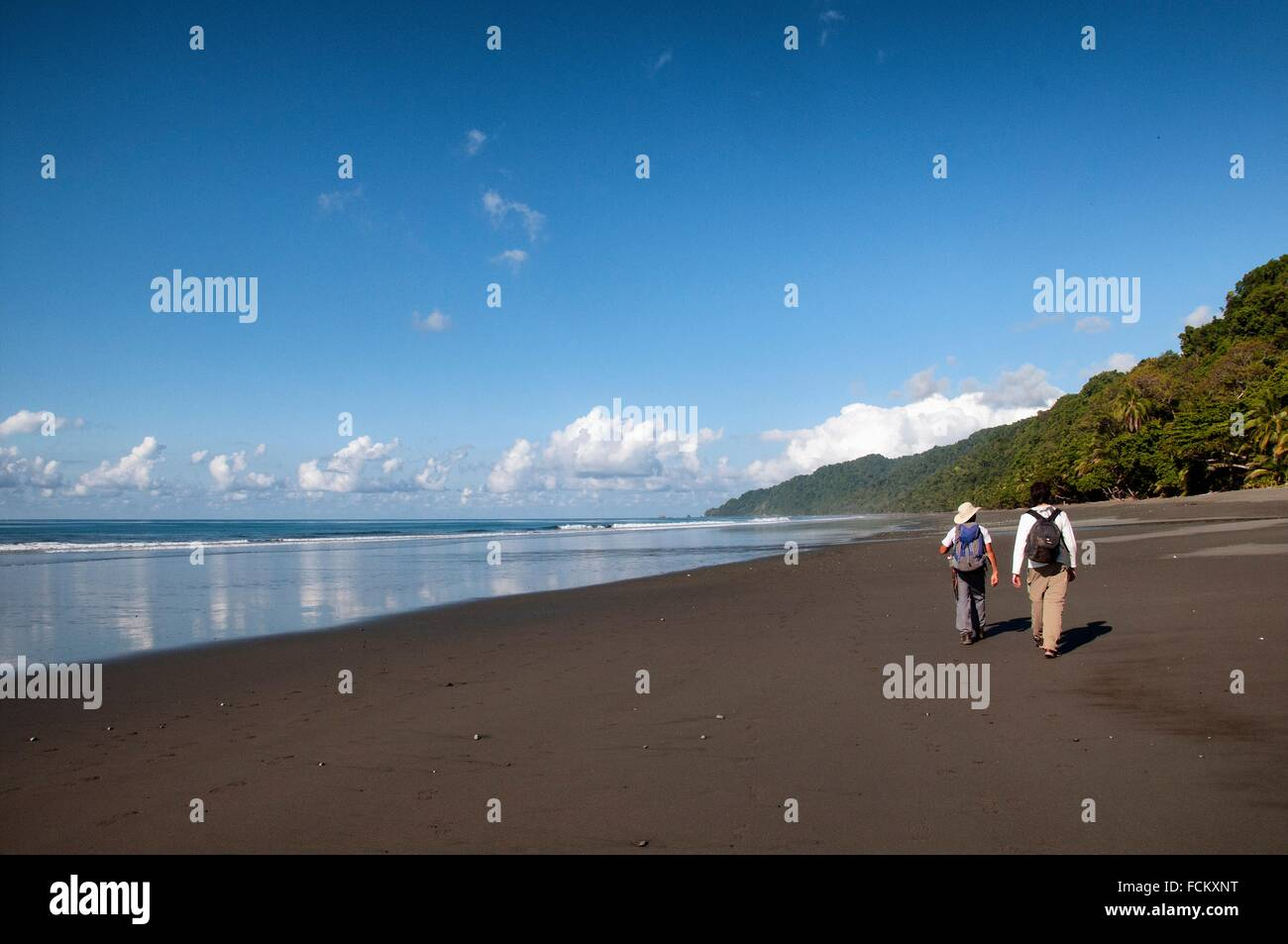 young male European traveller with local tourist guide, wild coast of the Pacific Ocean, Corcovado National Park, - Stock Image
