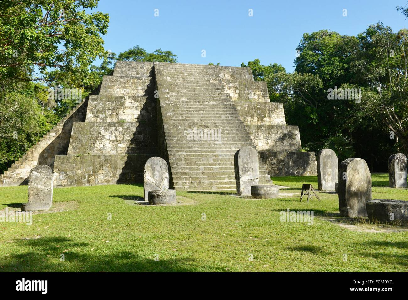 Small pyramid in precolumbian city of Tikal, Peten, Guatemala, Central America. - Stock Image