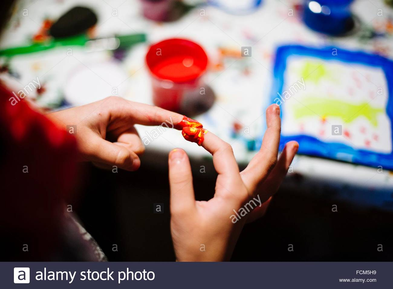 Child hands dirty with colored tempera - Stock Image