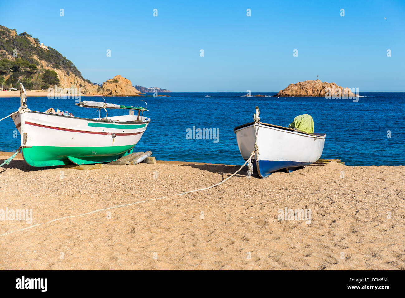 Fishermen's boat on a beach, Tossa de Mar, Costa Brava, Catalonia - Stock Image