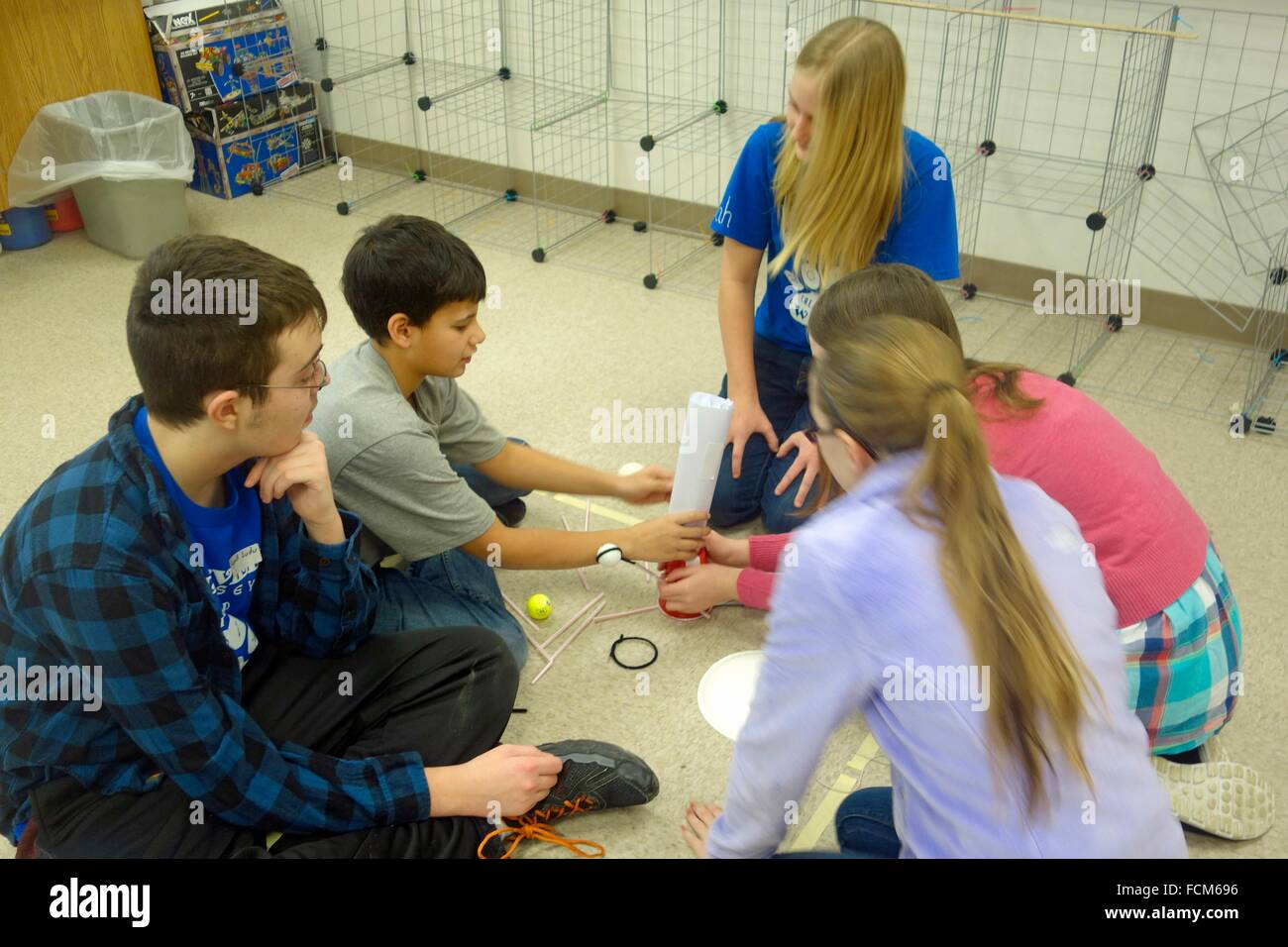 Teenagers Solving Spontaneous Problem, Wellsville, New York, United States. - Stock Image