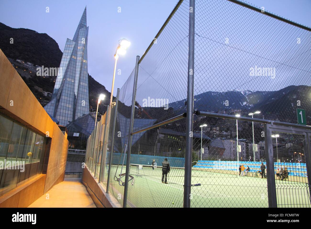 ANDORRA-FEBRUARY 23: People playing tennis in the city centre on February 23, 2013 in Andorra la Vella buildings Stock Photo