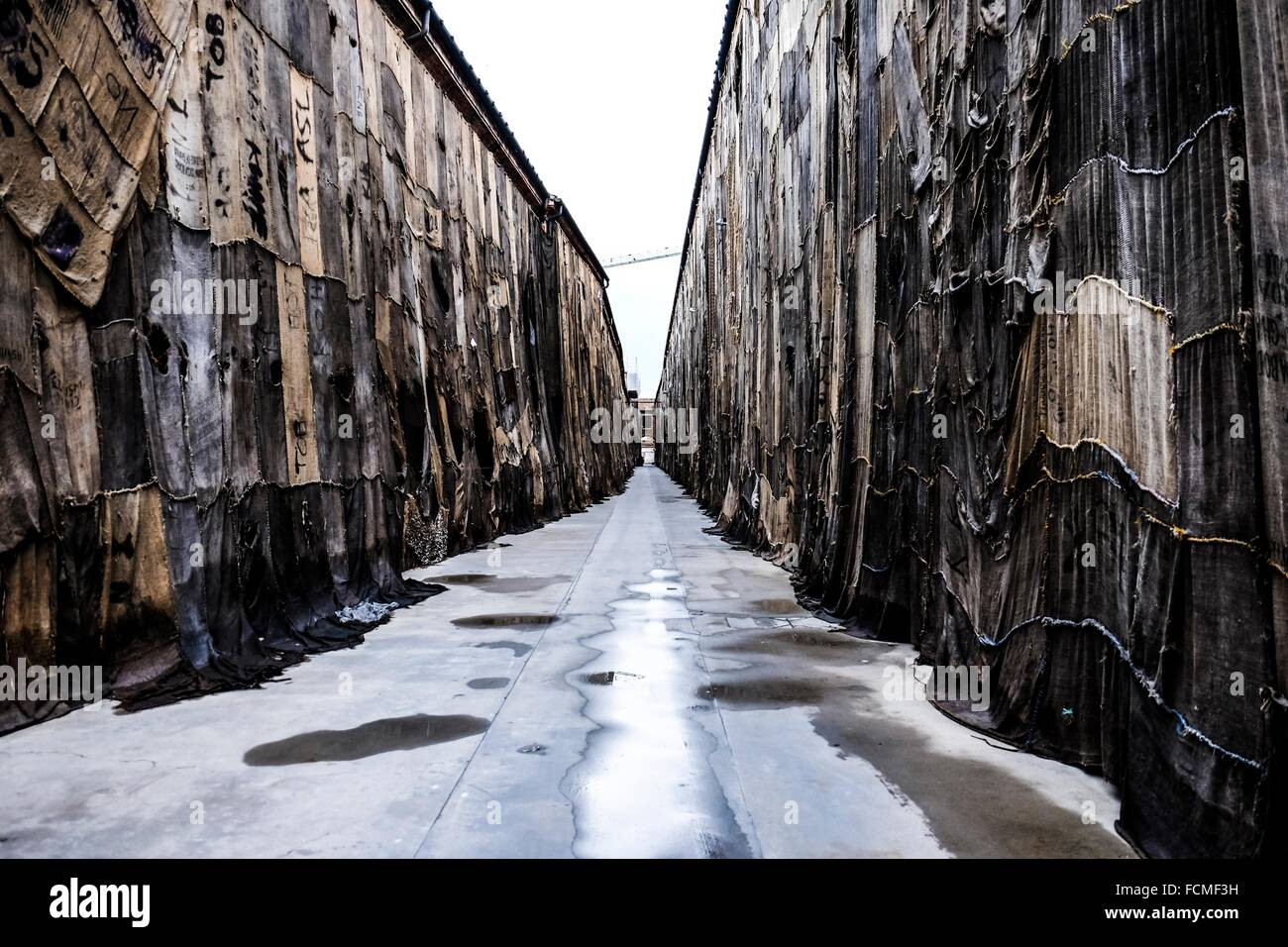 Street covered with jute sacks in Venice, Italy, Europe. - Stock Image