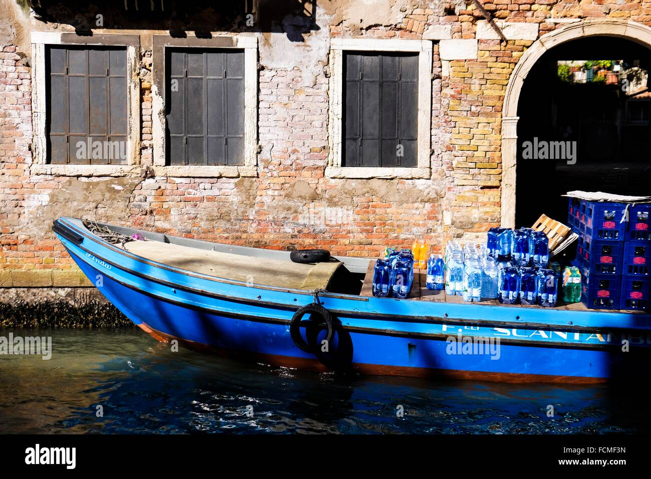 A bout with bottles in Venice, Italy, Europe. - Stock Image