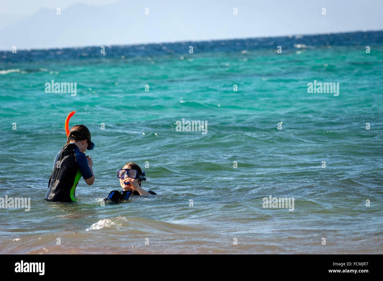 Mother and daughter go snorkeling in the Red Sea at Aqaba, Jordan. - Stock Image