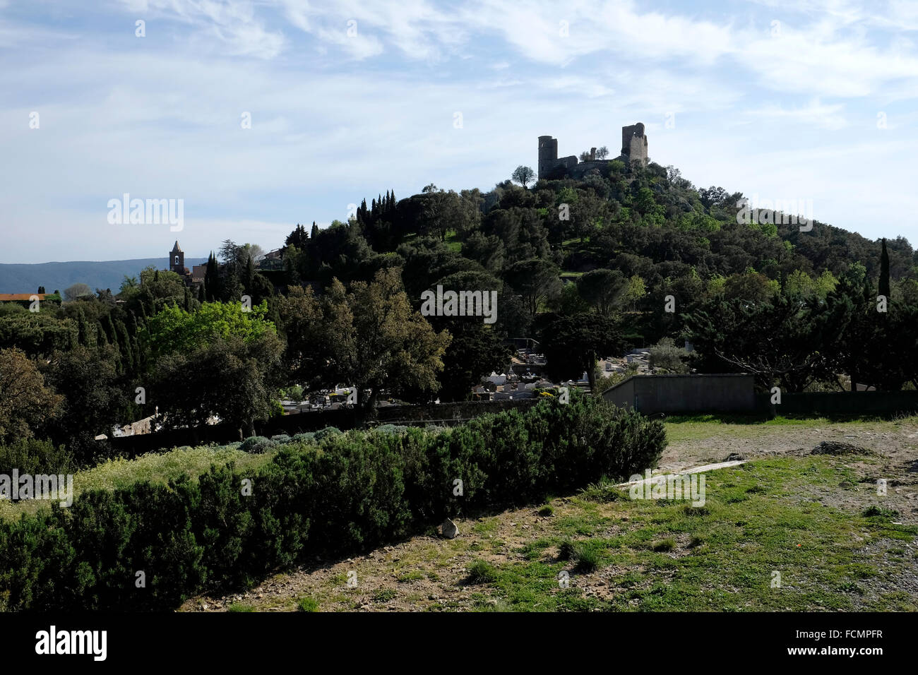 Grimaud, South of France, showing the ruined castle on top of the hill. - Stock Image