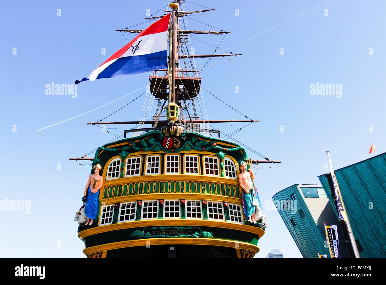 Maritime Museum and Dutch East India Company (VOC) ship, replica of the cargo ship from 1740, Amsterdam, Netherlands, - Stock Image
