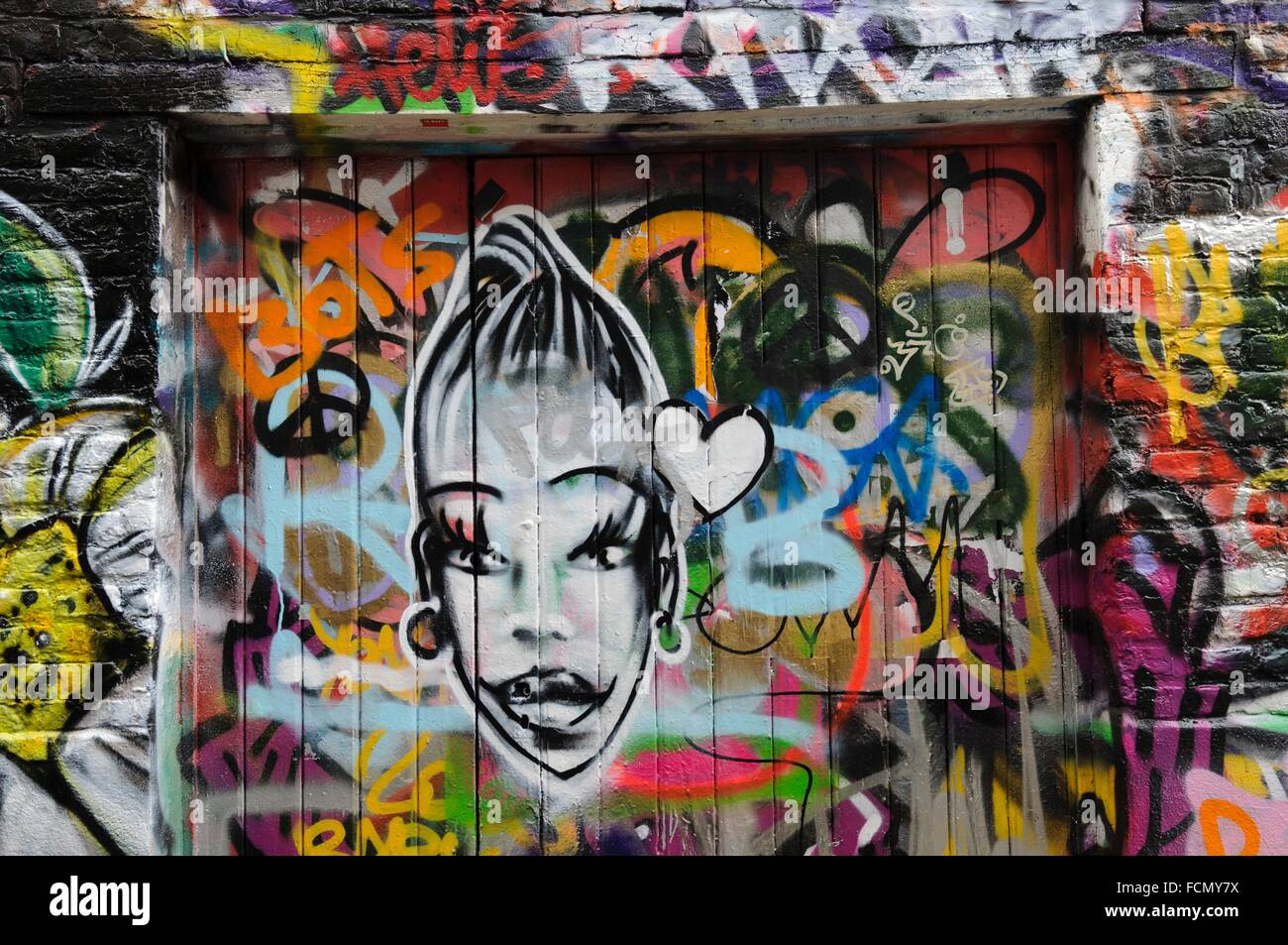 Horizontal View Of Graffiti Alley Werregaran Straat In Ghent With Two Young Girls Looking At