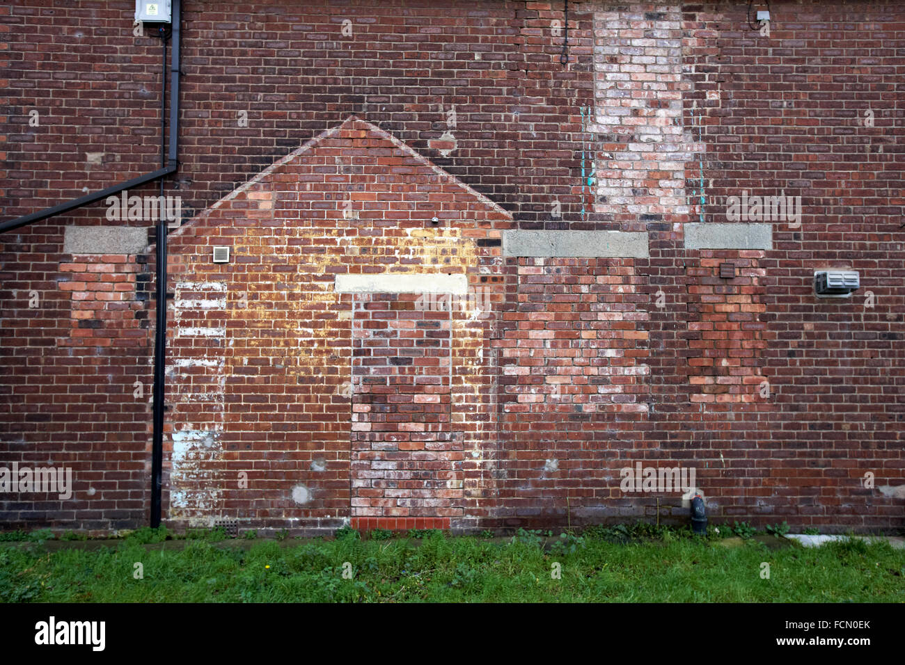 Signs of demolished house extension on outside wall UK - Stock Image