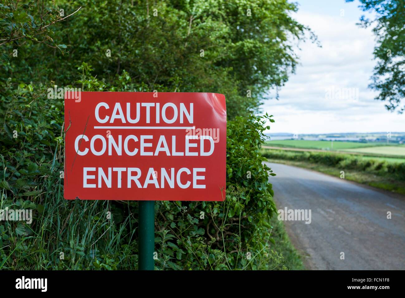 Sign warning of a concealed entrance. Shooting date 22.06.15 - Stock Image