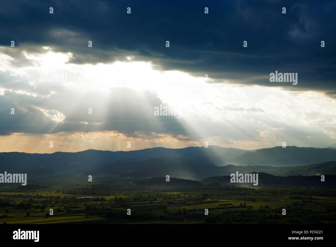 Afternoon sunrays falling over the Ljubljana Moors (Ljubljansko Barje), Slovenia. Seen from the church of Saint - Stock Image