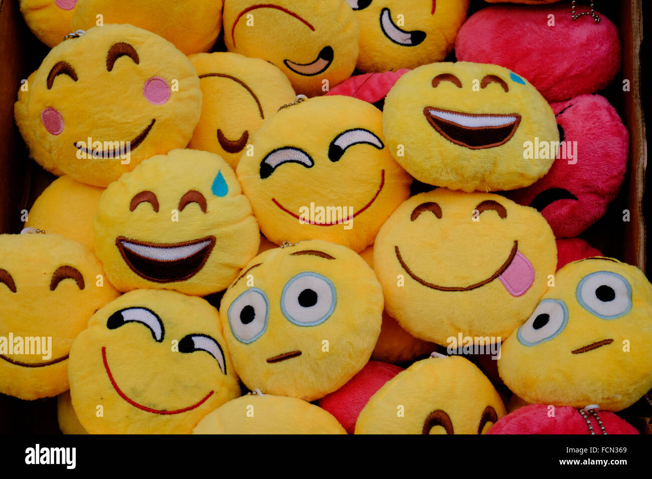 Emoji toys showing different emotions - Stock Image