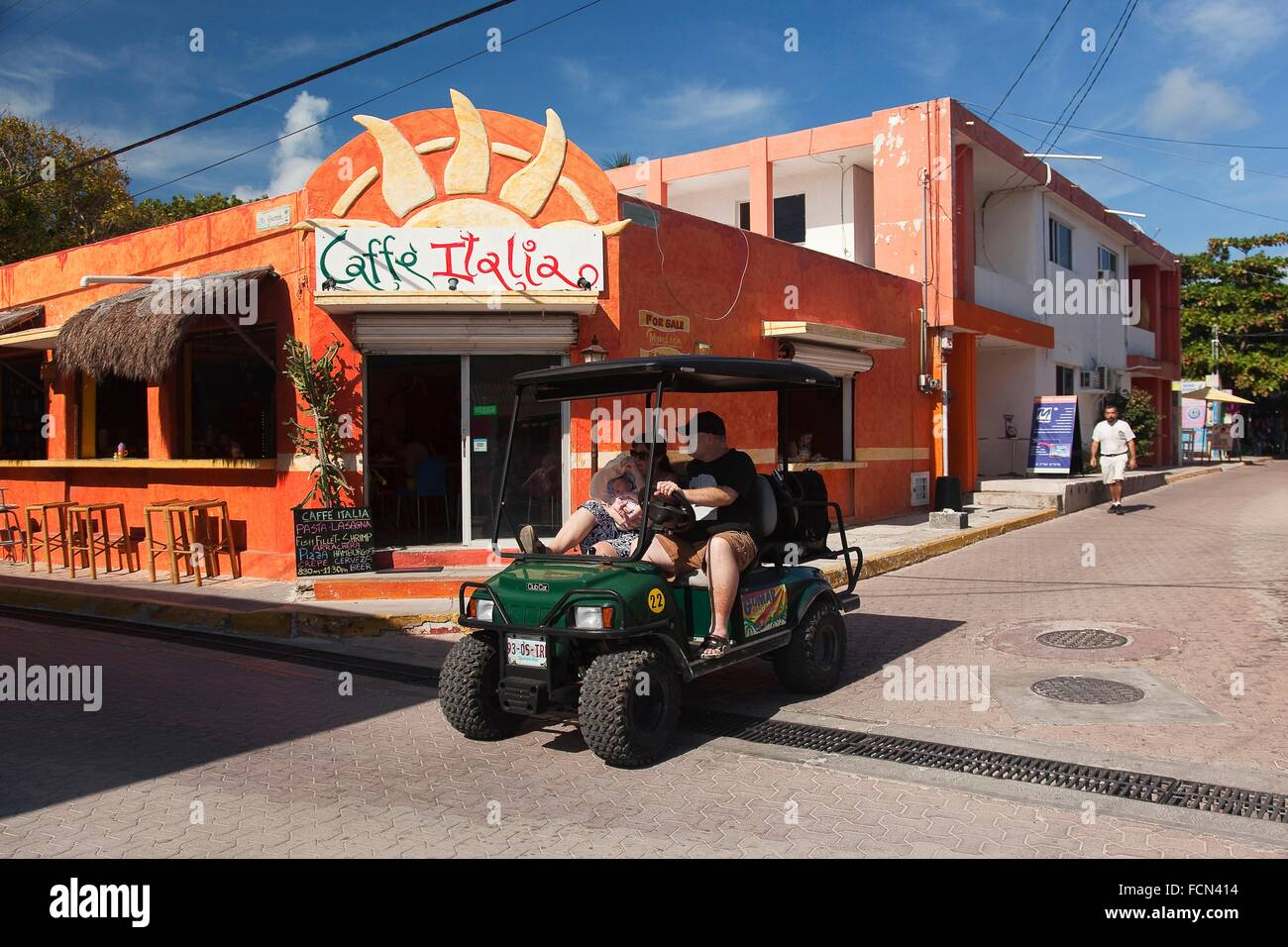 Tourst in a golf cart at town center, Isla Mujeres, Cancun, Quintana Roo, Yucatan Province, Mexico, Central America. - Stock Image