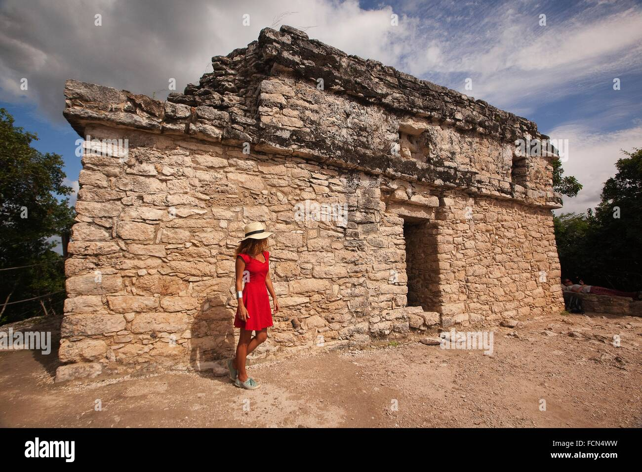 Tourists near the temple on the top of the Nohoch Mul Pyramid at the Prehispanic Mayan city of Coba Archaeological Stock Photo