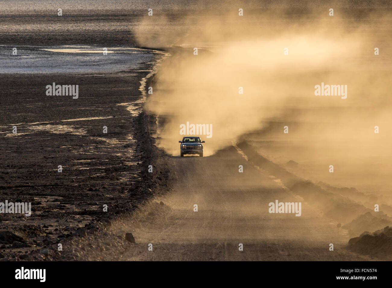 A pickup truck ascends up West Side Road from the Devil's Golf Course in Death Valley California. - Stock Image