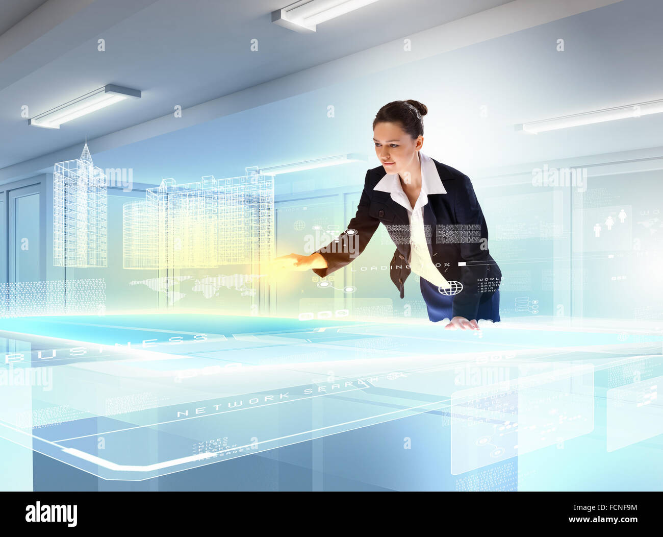 Image of young businesswoman clicking icon on high-tech picture - Stock Image