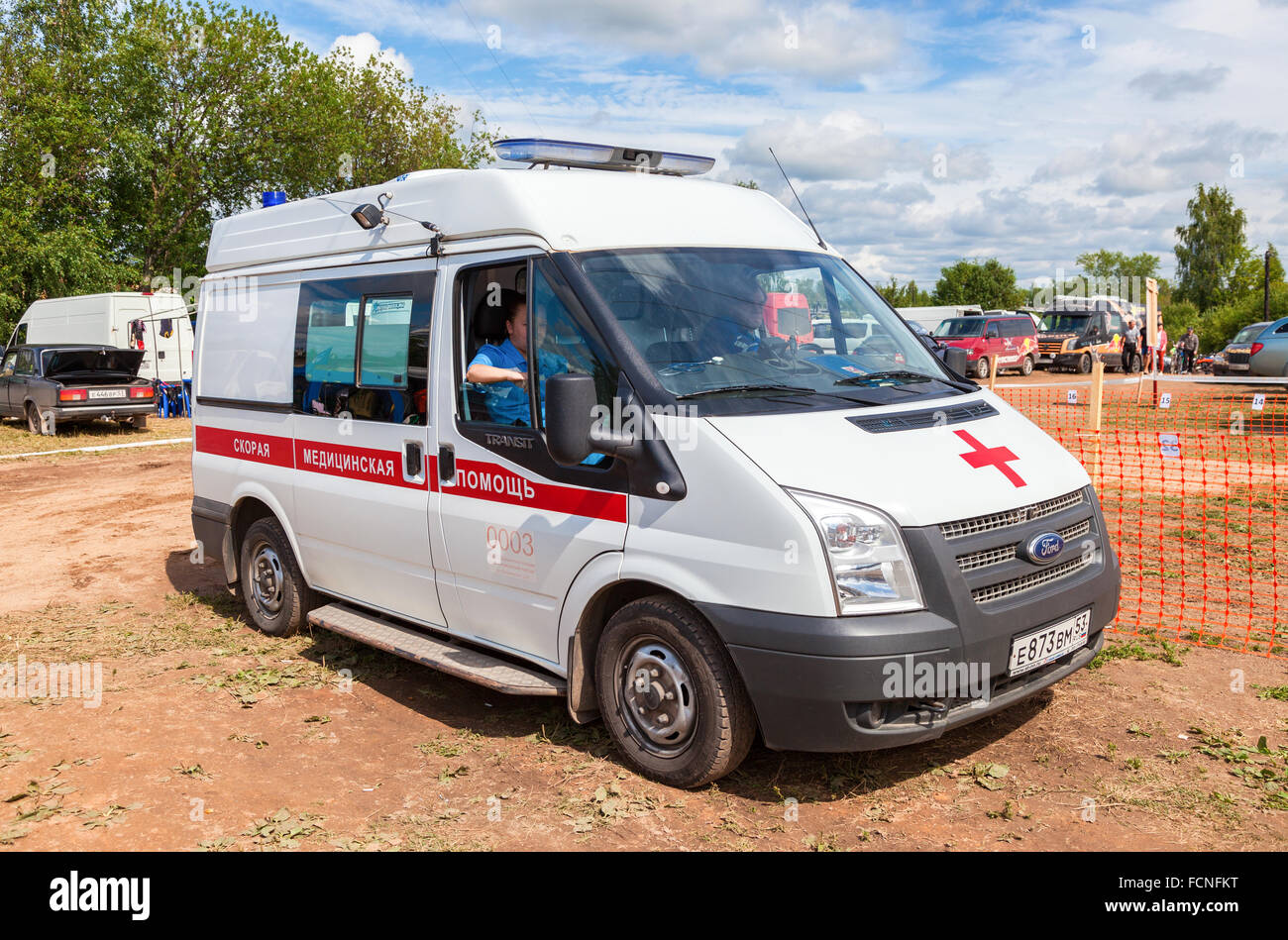 Ambulance car parked up in the rural street. Text on russian: 'Acute care' - Stock Image