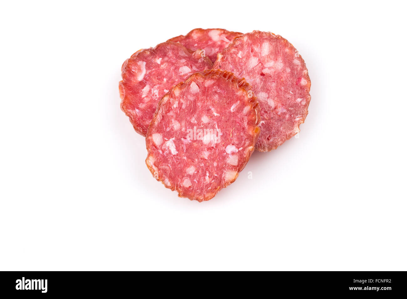 slices of salami isolated on a white background - Stock Image